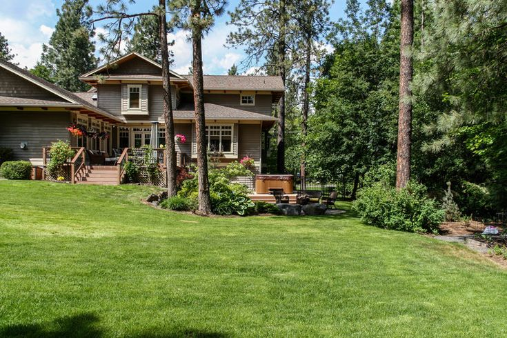 Craftsman house with multilevel deck and hot tub