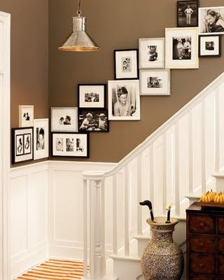Framed pictures along the stairs.