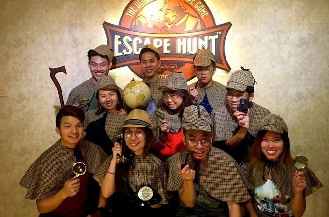 The Escape Hunt Experience Singapore Escape Hunt Experience Singapore, the ultimate live escape game, creates a world of mystery with clues, puzzles and cryptic messages — and it's up to you and your friends to figure them out. Based on classic 'escape-the-room' games that have grown in popularity worldwide, Escape Hunt lets you voyage back in time as you play the part of a London detective solving mysteries set in Singapore. This must-do attraction provides your party with a ...