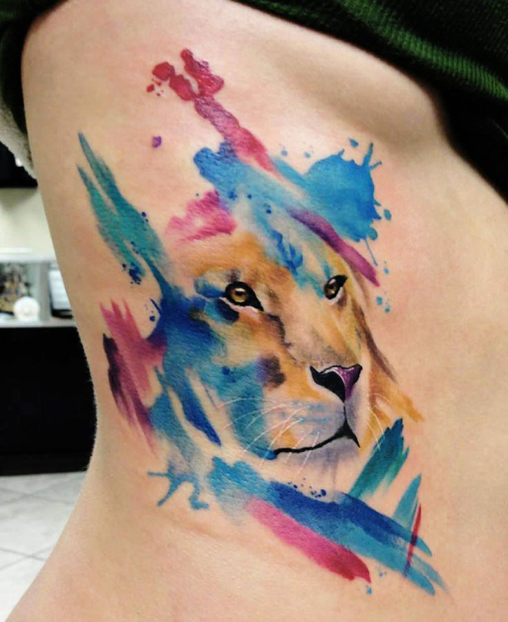abstract watercolor lion tattoo by mike schultz