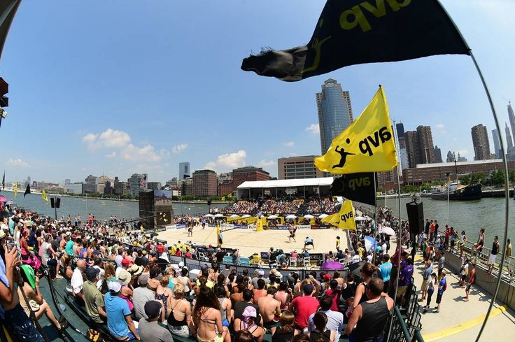 Professional volleyball players compete by the Manhattan waterfront.
