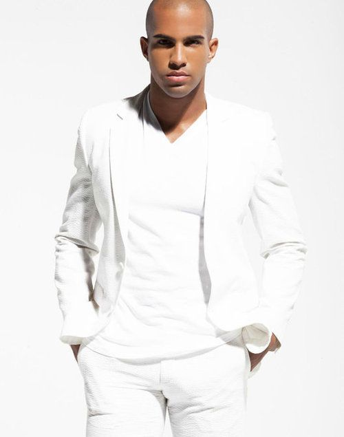 A gentlemen in all white attire by LeDiedraBaldwin.com