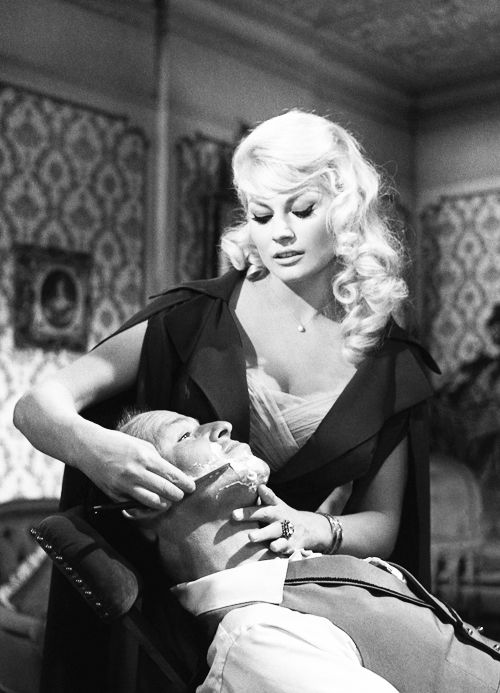 Anita Ekberg gives Frank Sinatra a shave in 4 for Texas, 1963