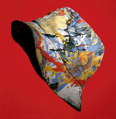 A paint-spattered bucket hat, as worn by drummer Reni of the Stone Roses