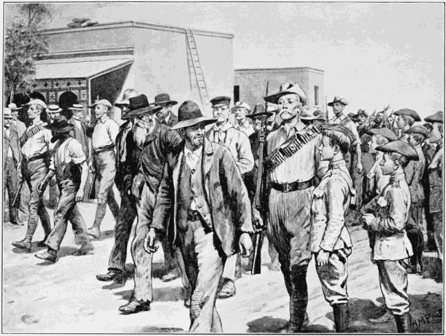 THE LAST ATTACK ON MAFEKING: B.S.A. POLICE ESCORTING BOER PRISONERS TO THE GAOL(note Baden Powell's Scouts standing at the right)
