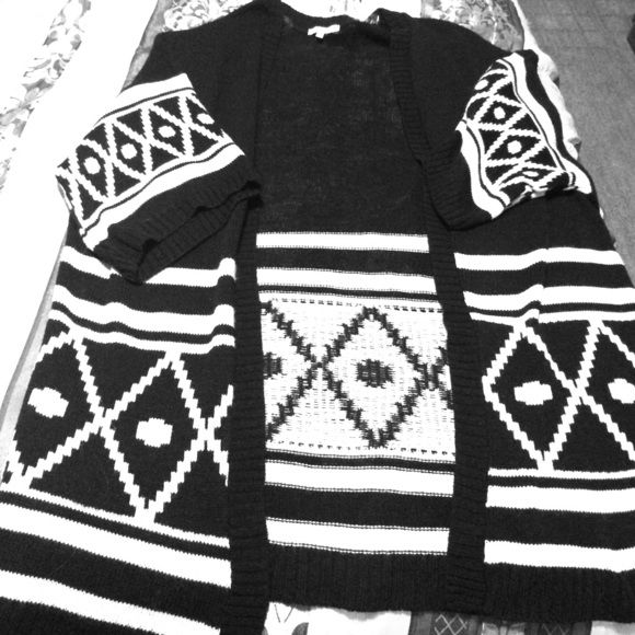 Tribal print cardigan Cute long cardigan. It is tribal print in black and white. Worn once. No damages or stains  Charlotte Russe Sweaters Cardigans