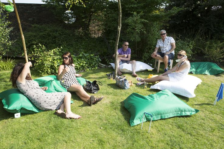 Green and white bean bags provided informal outdoor seating