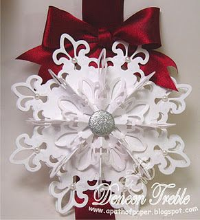 3-D Paper Snowflakes @A Path of Paper: I totally lifted my Snowflake Ornament from Becca Feeken and you can find her Tutorial HERE. I didn't use a ribbon spool like she did, I just used 2 circles from CS with the ribbon in between, I have a photo below to show that.  http://www.splitcoaststampers.com/resources/tutorials/fleurdelisornament/