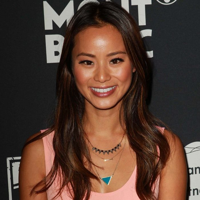 Jamie Chung showing off her her Stella & Dot On the Mark necklace
