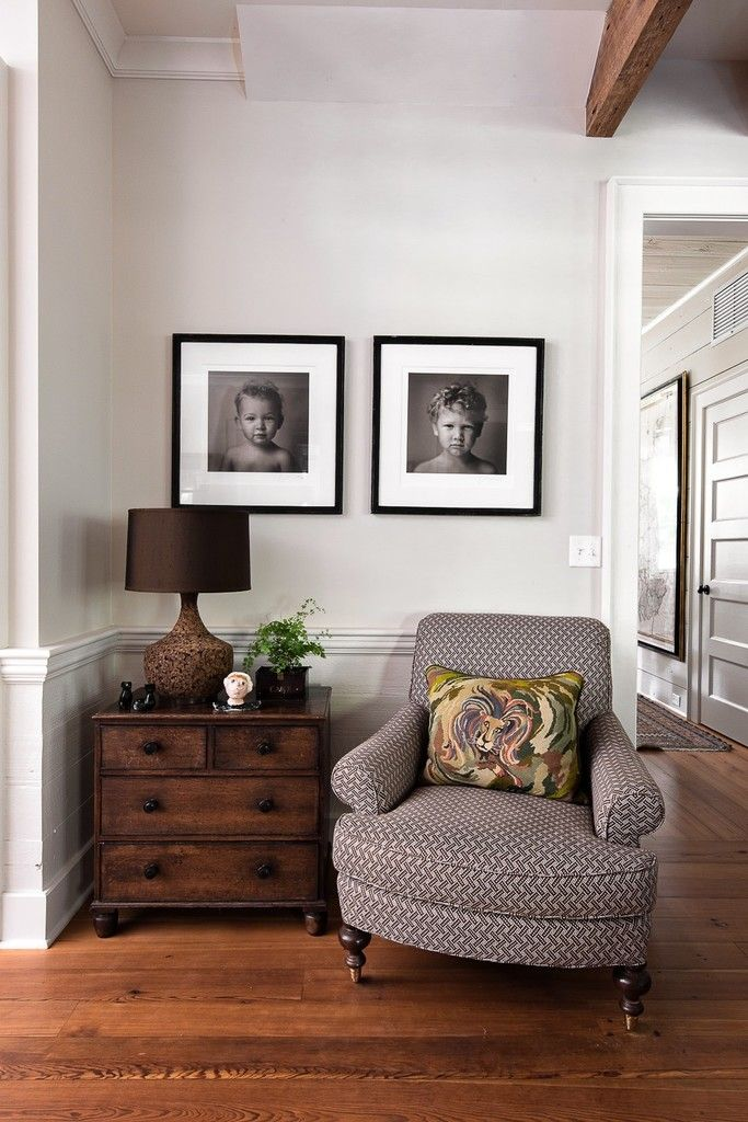 A country style corner in a home with artwork above it.
