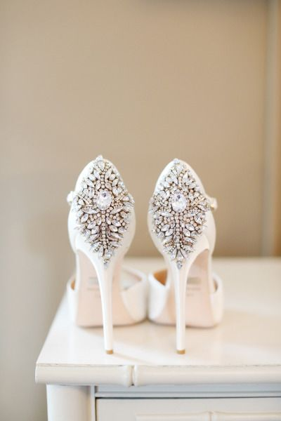 Stylish in the front, glam in the back on these Badgley Mischka heels: http://www.stylemepretty.com/2015/06/16/wedding-day-shoes-worth-showing-off/