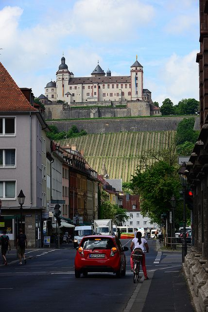 Wurzburg, Germany. The Romantic Road Bike Route starts near here gradually heading up the hill to the left side of the castle.