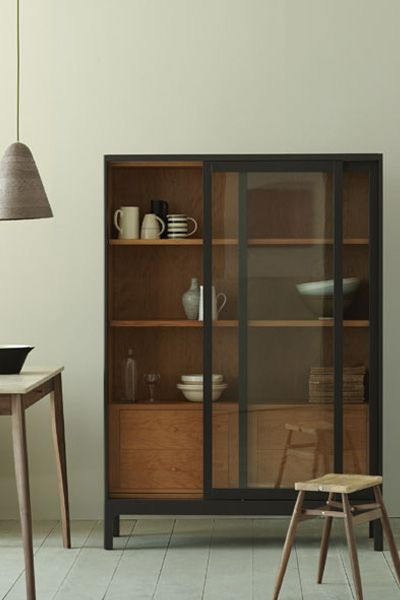 The Joyce cabinet is inspired by a Victorian optometrist's shopfitting. It has sliding glass doors and a cherry-lined interior with shelves and drawers, making it suitable for a variety of uses throughout your home.