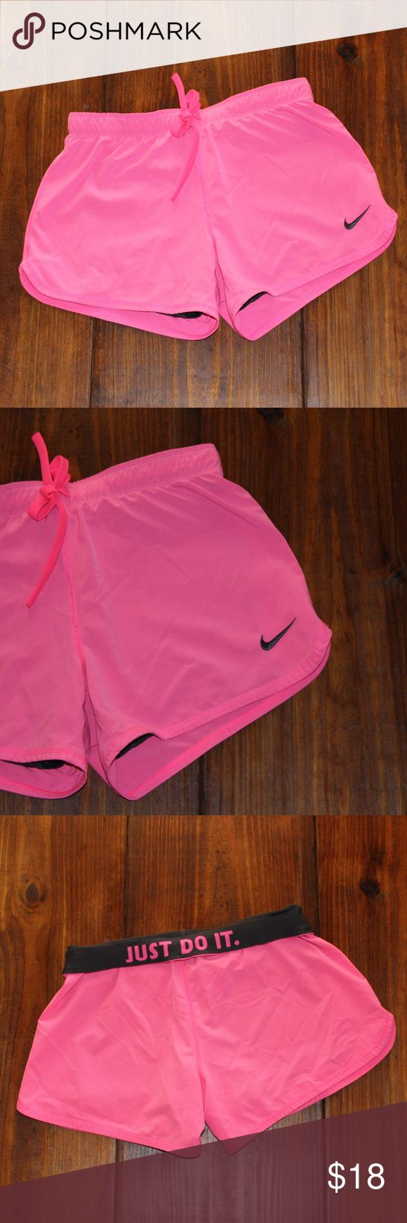 Nike   Women's Pink Phantom 2-in-1 Shorts Women's pink and gray Phantom 2-in-1 shorts, size S. A compressive inner short and woven outer layer combine for all-in-one enhancing design. An elastic waistband with draw cord allows for a personalized fit, and Dri-FIT technology wicks sweat for a cool feel. Move comfortably through your next workout in these Phantom 2-in-1 shorts. This item is in excellent used condition with little to no signs of wash or wear.  grey drifit Nike Shorts