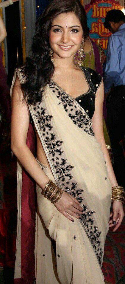 Bollywood actress in velvet saree blouse and pearl saree.