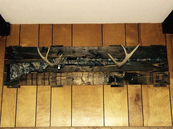 Pallet wood and antler gun rack.