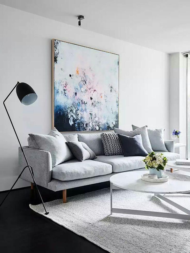 Grey sofa and blue artwork