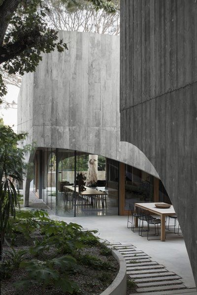 Photo 9 of 24 in Concrete Arches Shroud a Minimalist Forever Home in…