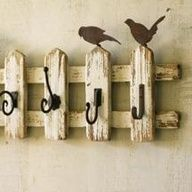 "Picket Fences: Salvaged  Repurposed. The little birds give it a cute touch. Love the variety of hooks used. Nice for #ShabbyChic decor. I am tempted to weave a thin garland of honeysuckle vine through this ... I want this now lol.  (shabby chic projects and #UpcycledFences) #HomeDecor"" data-componentType=""MODAL_PIN"