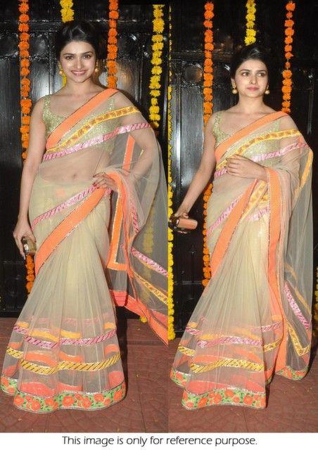 Bollywood Actress Prachi Desai Net Saree in Gold color