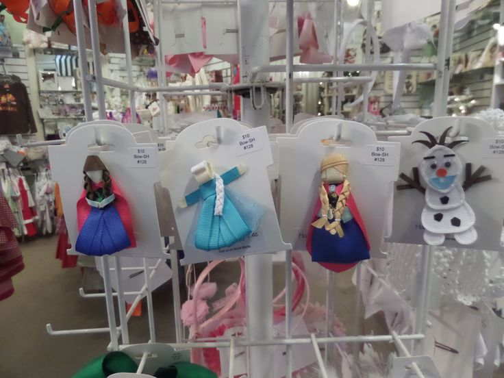 Your favorite girl will flip for these handmade Frozen hair clips by Sheri of Halos to Hissy Fits. These can be worn on their own, or fit inside the knot of a larger hair bow. Linda's Childrens Shoppe has matching smocked dresses in limited supply, too! #minthill #homestylesgallery #halostohissyfits #hairbow #hairbows #frozen #anna #elsa #olaf #minthillchildren #minthillkids #minthillbaby
