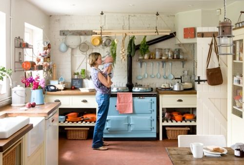 This kitchen is a bit too cluttered for me, but I like the idea. That stove is amazing.