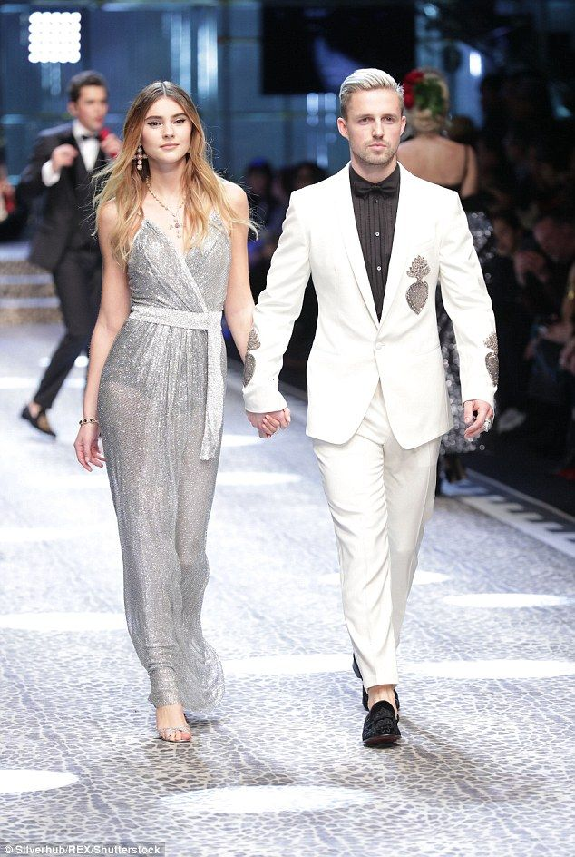 From screen to stage: YouTuber-turned-model Marcus Butler walked for the show in a crisp white suit with silver detailing