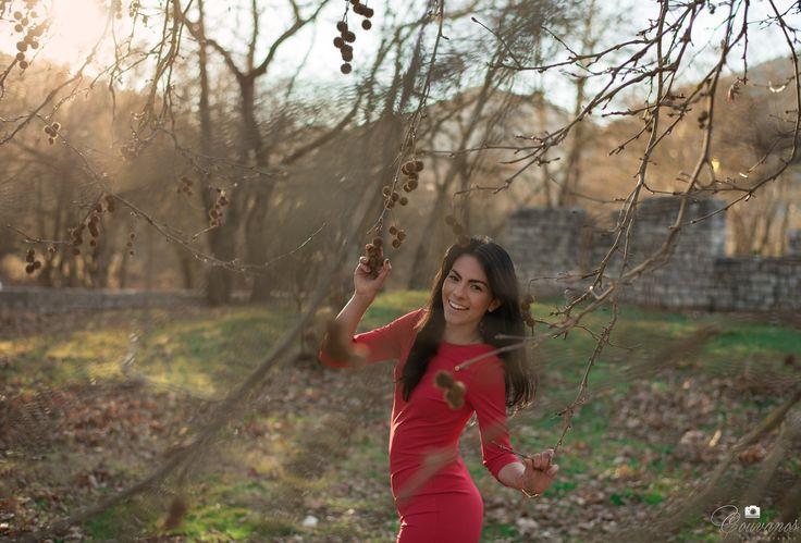 Woman in red dress somewhere in Karpenisi village.