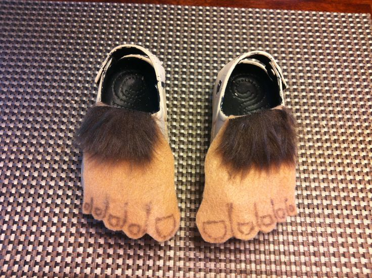 Toddler sized Hobbit feet - Black crocs from Walmart painted flesh colored, tan felt, fake fur. I'm proud of them!