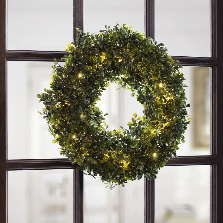 You'll get glowing reviews on our pre-lit wreath. Style your space with Kirklands.