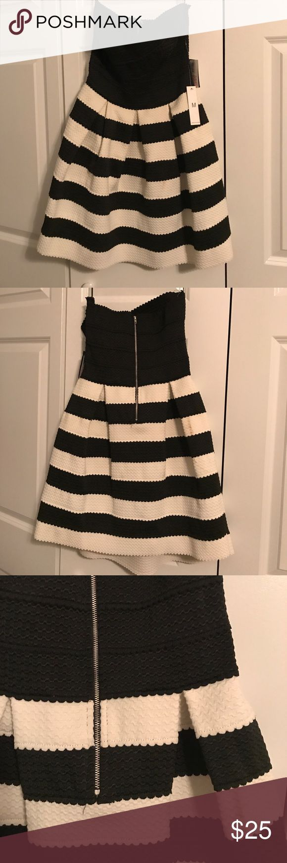 NWT black and white stripe strapless mini dress Black and white strapless mini dress. Exposed back zip. Very stretchy. Would be great for a cocktail party or wedding guest Teeze Me Dresses Strapless