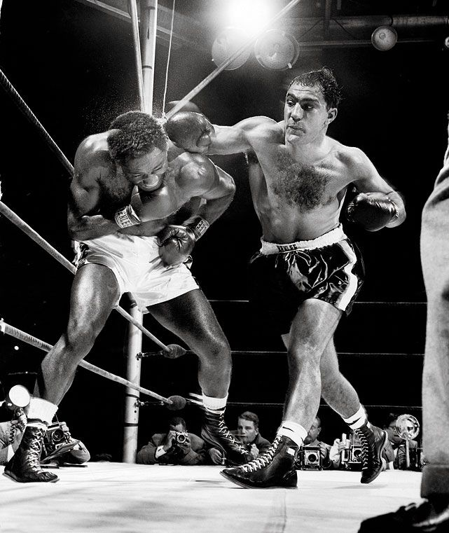 Rocky Marciano W 15 Ezzard Charles June 17, 1954 The first of two clashes between Marciano and Charles -- the current and former heavyweight champions, respectively -- took place between 47,585 fans at Yankee Stadium. Marciano suffered a gruesome cut in the fourth round but still came away with the unanimous decision.