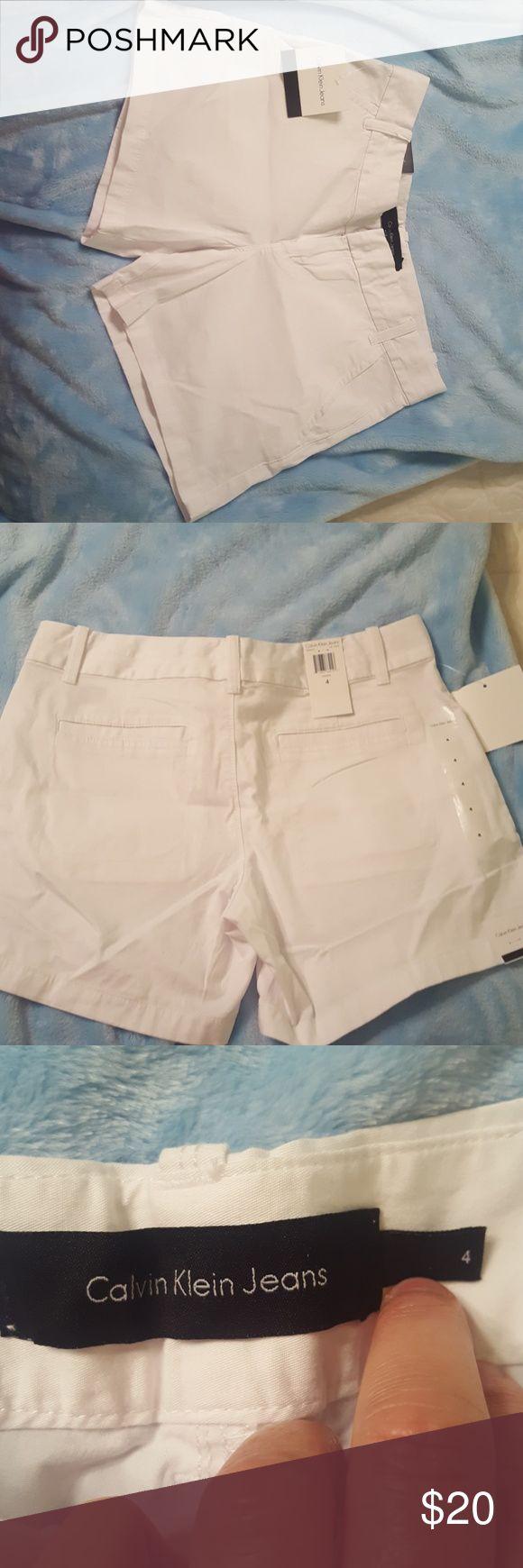 """Calvin Klein white shorts size 4. Calvin Klein white shorts size 4. 5""""'inseam. NWT. Non smoking home. Calvin Klein Shorts"""