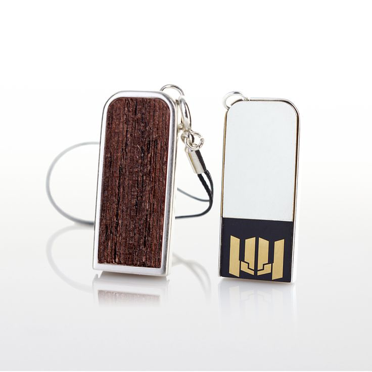 ZaNa Mobile Flash Wenge is a very neat stick specifically designed as a pendant to your mobile phone. The metal casing of this little miracle is covered with a layer of pure silver, 999 fineness Complementing the unique design are used inserts with exotic Wenge wood