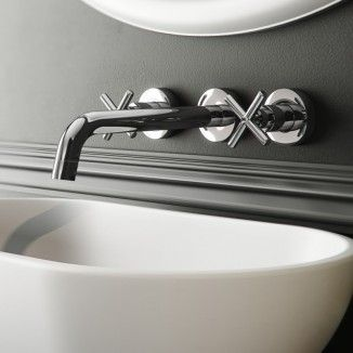 Create a minimalist feeling in your bathroom by installing this Mirella Wall Mounted Basin Mixer. With two cross top taps and a single spout all mounted to the wall, this bathroom accessory will inject a contemporary flair due to its simple style. Pair wi