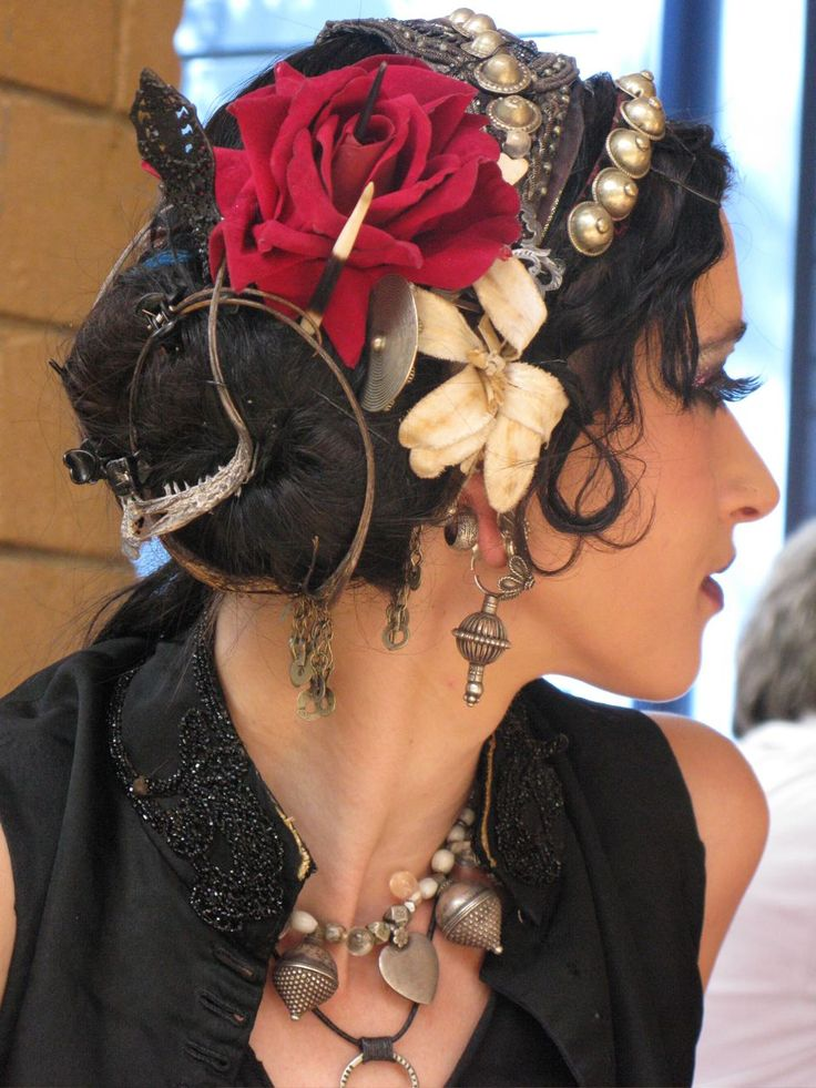 this what i think of when i think gypsy :) Roses and hair jewelry