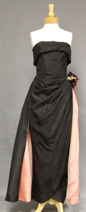 A bombshell evening gown from the 60s - I remember my mother's Barbie doll had this dress, complete with rose.
