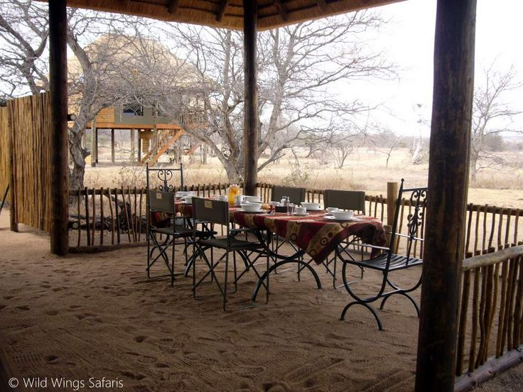 Breakfast table laid out at nThambo Lodge, overlooking the Klasserie bushveld.
