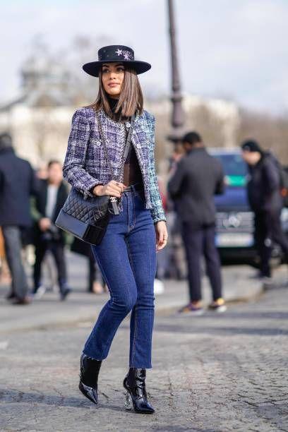 ceb6805e Camila Coelho wears a hat a tweed jacket blue jeans a Chanel black bag  outside Chanel during Paris Fashion Week Womenswear Fall/Winter 2018/2019  on.