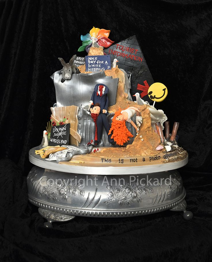Dismal Wedding Cake inspired by Dismaland and Bansky. Created without using any moulds just the amazing sugarcraft skills of Ann Pickard.