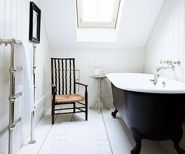 Roll top bath / shutters on velux / panelling on bathroom wall - simple & elegant