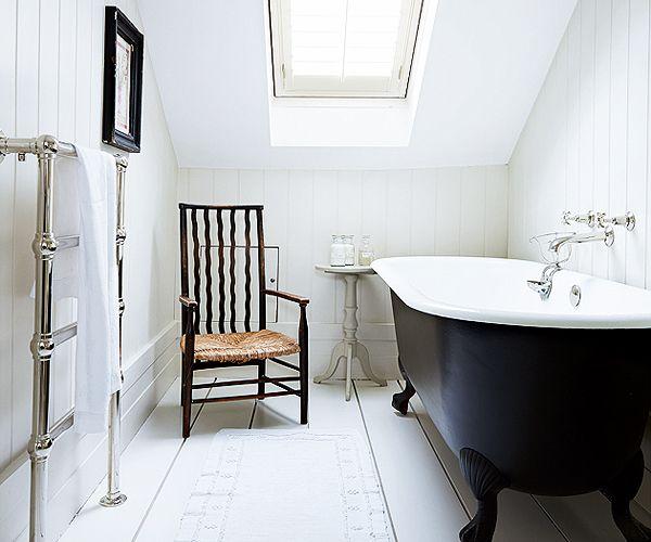 Roll top bath / shutters on velux / panelling on bathroom wall - simple & elegant
