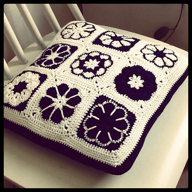 Crochet Granny Square pillow with zipper.