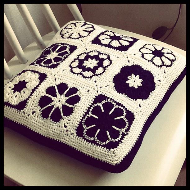 Crochet Granny Square pillow with zipper.