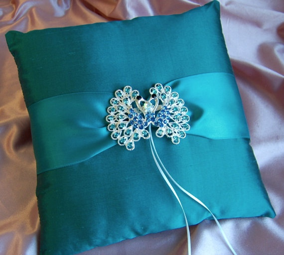 Peacock Wedding  Peacock Blue Ring Bearer Pillow by All4Brides, $50.00 Ashley T wedding eggplant pillow w/ white wide lace NO bow... a silver diamond brooch in the center.