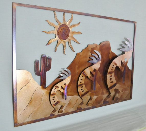 "Give your home a piece of Kokopelli's glory and mystique with this hand cut one of a kind piece of Southwestern metal wall art. All my pieces are hand-drawn onto metal and then hand-cut. No automation or computers are used. A clear coat of lacquer protects the piece but no patinas or paints are used. For this reason, it is impossible to make a duplicate, each piece will always be unique! Dimensions: H: 20"" W: 31"" D: 0.5"" Weight: 8 lbs."