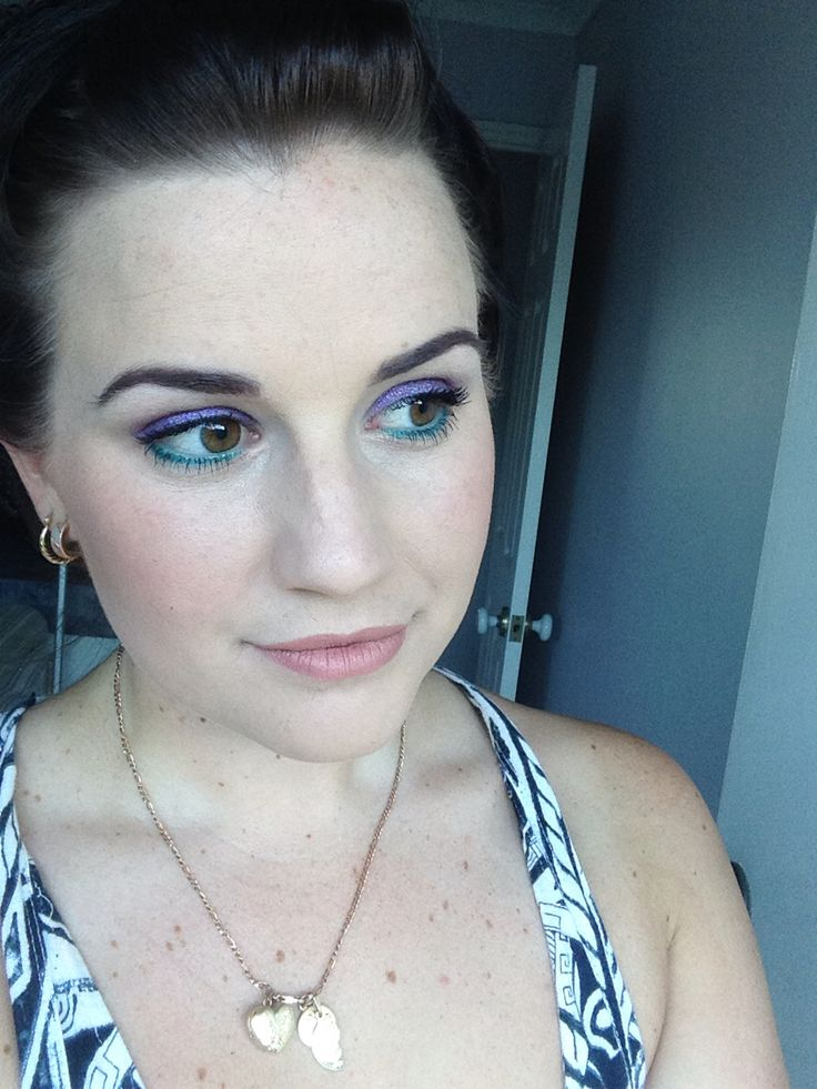 Purple and turquoise eyes with nude lips