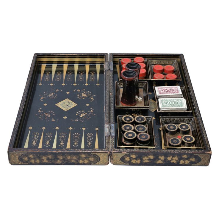 Antique Victorian folding papier mache lacquered games box with chess and checkers board on the exterior and backgammon inside. Hand painted and gilded. Complete set of draughts, dice, dice shakers, trays, and two small decks of playing cards.  Dimensions below are closed dimensions.