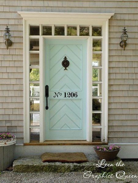 welcoming front door love the color and the numbers painted on it