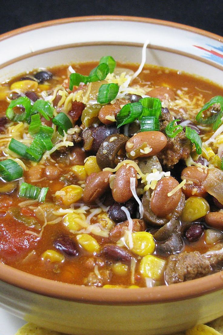 Slow Cooker Ranch Taco Soup Recipe with ground beef, pinto beans, kidney beans, corn, tomatoes, green chiles, olives, taco seasoning, and ranch dressing mix.